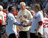 BOSTON -- Former Boston Red Sox pitcher Pedro Martinez, left, greets fellow Red Sox pitching alumni Joe Sambito, right and Jim Lonborg on the field during the special pregame ceremony celebrating the 100th anniversary of Fenway Park on Friday, April 20, 2012. (Brita Meng Outzen/Boston Red Sox)
