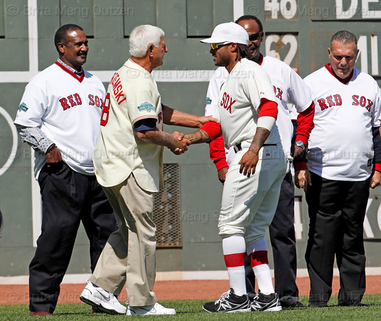 BOSTON -- Boston Red Sox outfielder Darnell McDonald, center, greets Red Sox alumnus and Hall of Famer Carl Yastrzemski on the field during the special pregame ceremony celebrating the 100th anniversary of Fenway Park on Friday, April 20, 2012. (Brita Meng Outzen/Boston Red Sox)