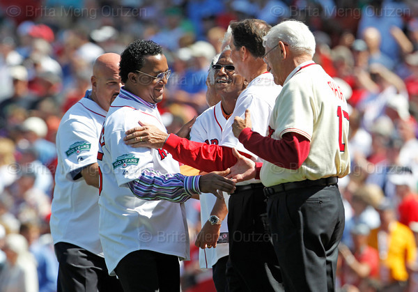 "BOSTON -- Former Boston Red Sox pitcher Pedro Martinez, second from left, gets a warm greeting from fellow alumni pitchers, from left, Jim Corsi, Dennis ""Oil Can"" Boyd, Bruce Hurst and Billy Rohr on the field during the special pregame ceremony celebrating the 100th anniversary of Fenway Park on Friday, April 20, 2012. (Brita Meng Outzen/Boston Red Sox)"