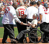 BOSTON -- Former Boston Red Sox first baseman Mo Vaughn, left, shakes hands with fellow alumnus Johnny Pesky during the special pregame ceremony celebrating the 100th anniversary of Fenway Park on Friday, April 20, 2012. (Brita Meng Outzen/Boston Red Sox)