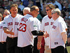 BOSTON -- Former Boston Red Sox catcher Dave Valle, center, greets former Red Sox manager Joe Morgan and fellow alumnus Carlton Fisk at home plate during the special pregame ceremony celebrating the 100th anniversary of Fenway Park on Friday, April 20, 2012. (Brita Meng Outzen/Boston Red Sox)