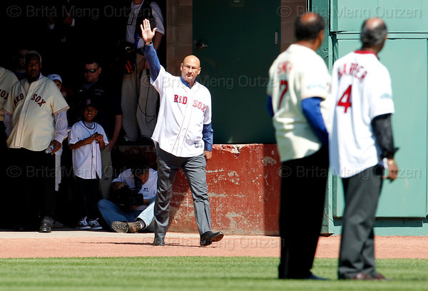 BOSTON -- Former Boston Red Sox manager Terry Francona waves as he walks onto the field during the special pregame ceremony celebrating the 100th anniversary of Fenway Park on Friday, April 20, 2012. (Brita Meng Outzen/Boston Red Sox)