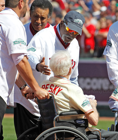 BOSTON -- Former Boston Red Sox pitcher Luis Tiant, right, comforts fellow Red Sox alumnus Johnny Pesky as players leave the field at the end of a special pregame ceremony celebrating Fenway Park's 100th anniversary on Friday, April 20, 2012. (Brita Meng Outzen/Boston Red Sox)