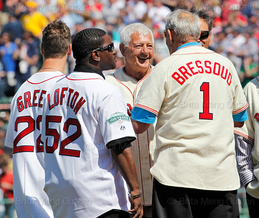BOSTON -- Former Boston Red Sox left fielder and Hall of Famer Carl Yastrzemski, second from right, is greeted by fellow Red Sox alumnus Ed Bressoud, right, as Nick Green and James Lofton watch on the field as he walks to his position on the field during the special pregame ceremony celebrating the 100th anniversary of Fenway Park on Friday, April 20, 2012. (Brita Meng Outzen/Boston Red Sox)