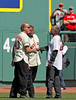 BOSTON -- Former Boston Red Sox player Tommy Harper, right, is greeted by former players Billy Conigliaro, left and Reggie Smith o the field during the special pregame ceremony celebrating the 100th anniversary of Fenway Park on Friday, April 20, 2012. (Brita Meng Outzen/Boston Red Sox)