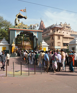 Crowds waiting to enter the Krishna Jnam Sthan Temple (Temple of Lord Krishna's birth place) in Mathura on the festival of Holi.  Festival of Holi (Festival of Colours) is celebrated with great fervour and gusto in the city of Vrindavan, Mathura, UP, India.