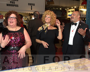 Magazine Publisher Laura Burkhart, Sharon Pinkenson (Executive Director, Greater Philadelphia Film Office) and Seth Williams, Philadelphia District Attorney.  The Valentine to the Market Gala, Saturday, February 23, 2013. ( Al B. For / Philly.com )