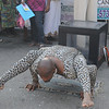 """This was a bit odd.  Near the food court, this brother was a """"kinda"""" controtionist.  I'm not sure what he was doing.  It look like he just rolled to the Festival in a leopard suit."""