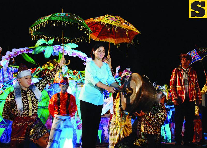 DAVAO. City Mayor Sara Duterte-Carpio bangs the agong to mark the opening of the 27th Kadayawan sa Dabaw celebration at the People's Park on Friday evening. (King Rodriguez)