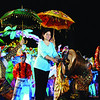 DAVAO. City Mayor Sara Duterte-Carpio bangs the agong to mark the opening of the 27th Kadayawan sa Dabaw celebration at the People's Park on Friday evening. (King Rodriguez)
