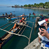 Sama divers, known to many as the Badjaos, listen to American national, Luke Schroeder, as he shares some words of wisdom in a Sama dialect in Thursday's opening ceremony of the 1st Kadayawan Sama Freediving Contest at Sta. Ana Wharf before proceeding to Talikud Island for the competition proper.  Schroeder talks in Sama dialect fluently because he has been married to a Badjao for years already. (King Rodriguez photo/Sun.Star Davao)