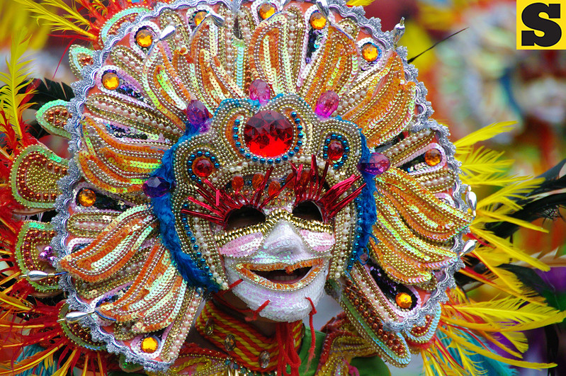 BACOLOD. A student of the Education Training Center Schools II flaunts his mask during the Masskara 2012 dance competion - elementary division on Saturday held at the city's public plaza. (Photo by Mildred Galarpe)
