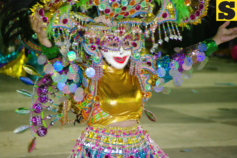 LAST BUT NEVER THE LEAST. This dancer of Barangay 17 graces in front of the crowd during the 2012 Masskara Streetdance Competition-Barangay Category on Sunday. Barangay 17 won this year's championship crown among fourteen other participants. (Photo by Mildred Galarpe)