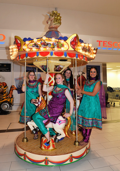 Bollywood Dance Dublin enjoy a moment on the Merry Go Round at Nutgrove Shopping Centre during the launch of Nutgrove Arts Fest 2013. L to R: Siobhan Hargis, Emer Wall, Jennifer Burke and Claudia Martinez.<br /> <br /> An Cathaoirleach Cllr Carrie Smyth launched Nutgrove Arts Fest 2013 on Thursday 26 September 2013. The event took place from 6.30pm to 8.30pm and included Musicians Shannen Byrne & Michéal Smith from Kicking Bird, The Bastable Warren School of Irish Dancing, Bollywood Dance Dublin, Independent Theatre Workshop and RUGS Ukelele Band.