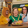 Someone is watching as the Cathaoirleach tries to taste one of the lovely cakes from Quigleys in the Nutgrove Shopping Centre.  Featuring L to R: 'The Cowardly Lion',Colleen Hogan, An Cathaoirleach Cllr Carrie Smyth and 'Dorothy' Niamh Casey.<br /> <br /> An Cathaoirleach Cllr Carrie Smyth launched Nutgrove Arts Fest 2013 on Thursday 26 September 2013. The event took place from 6.30pm to 8.30pm and included Musicians Shannen Byrne & Michéal Smith from Kicking Bird, The Bastable Warren School of Irish Dancing, Bollywood Dance Dublin, Independent Theatre Workshop and RUGS Ukelele Band.