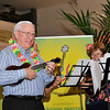 RUGS (Rathfarnham Ukelele Group) - A colourful Ukelele Band entertained the audience with a variety of songs and playing. Image features Tommy Sheridan.<br /> <br /> An Cathaoirleach Cllr Carrie Smyth launched Nutgrove Arts Fest 2013 on Thursday 26 September 2013. The event took place from 6.30pm to 8.30pm and included Musicians Shannen Byrne & Michéal Smith from Kicking Bird, The Bastable Warren School of Irish Dancing, Bollywood Dance Dublin, Independent Theatre Workshop and RUGS Ukelele Band.