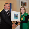 An Cathaoirleach Cllr Carrie Smyth was presented with a Chris McMorrow painting by Centre Manager Seán Aylward at the launch.<br /> <br /> An Cathaoirleach Cllr Carrie Smyth launched Nutgrove Arts Fest 2013 on Thursday 26 September 2013. The event took place from 6.30pm to 8.30pm and included Musicians Shannen Byrne & Michéal Smith from Kicking Bird, The Bastable Warren School of Irish Dancing, Bollywood Dance Dublin, Independent Theatre Workshop and RUGS Ukelele Band.