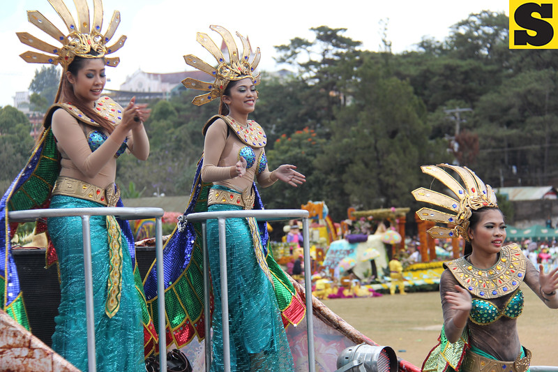 International Pharmaceuticals Inc. (IPI) dancers perform onboard IPI's Panagbenga 2014 float