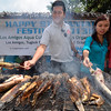 DAVAO. Sun.Star Davao reporter Ara Casas and TV5's Mike Pasco roast fresh and tasty catfishes at the opening of the two-day 9th Pantatan Festival in Los Amigos, Tugbok District in Davao City Thursday. (King Rodriguez)