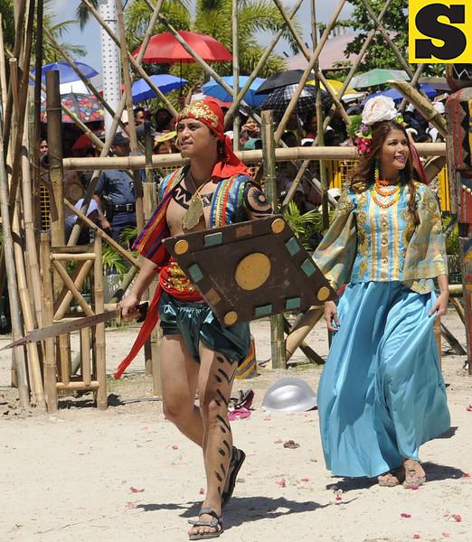 KADAUGAN SA MACTAN. Actors Richard Quan and Geneva Cruz play Datu Lapu-Lapu and wife Bulakna during the reenactment of the Battle of Mactan. (Photo by Allan Cuizon)