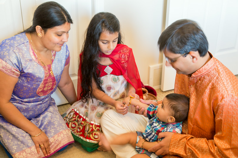 Sakshi Tying Rakhi to Kirtan