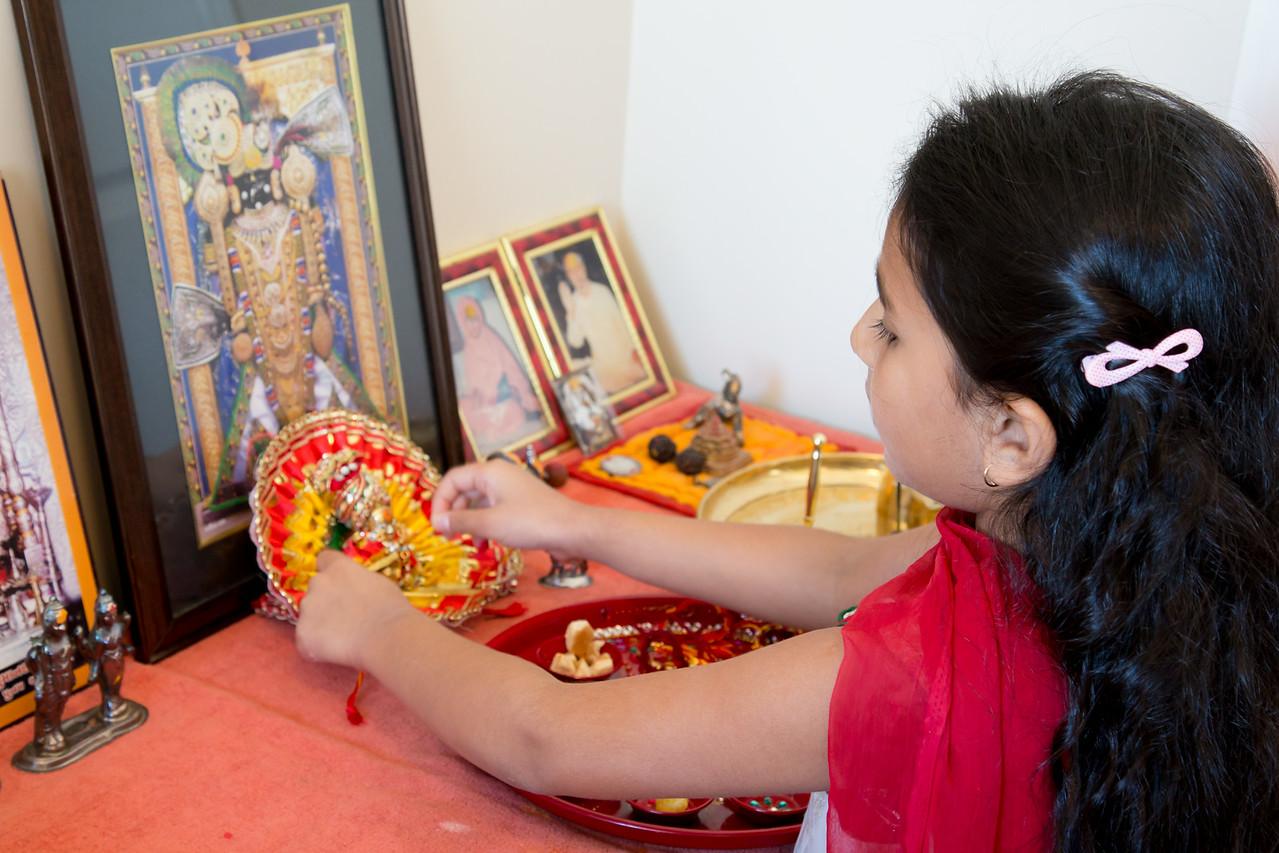Sakshi Tying Rakhi to Lord Krishna