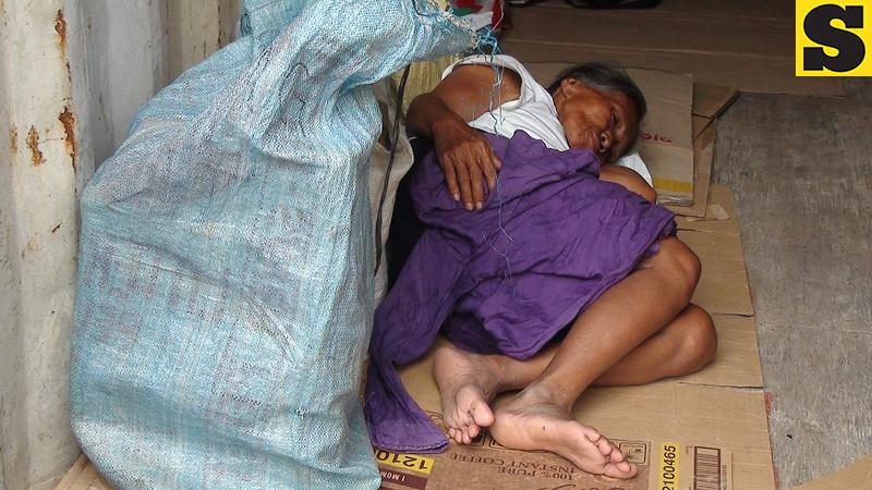 A devotee sleeps inside the makeshift shelter inside the Devotee City.