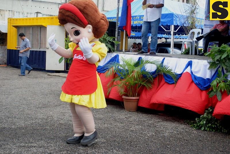 Julie's bakeshop mascot entertains the devotees and guests during the launching on Friday.