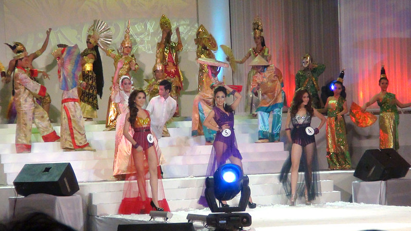 Ms Cebu 2012 candidates 4, 5 and 6 in their swim wear. At the back are dancers wearing Asean costumes. (Sunnex photo)