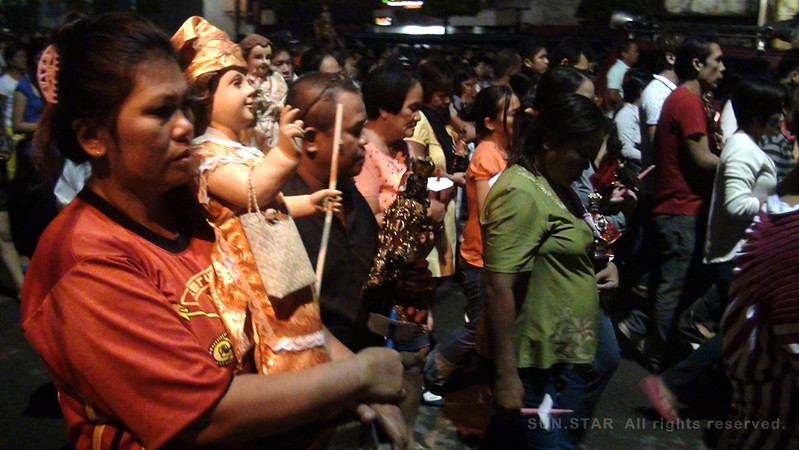One of the thousands of Sto. Nino devotees who joined the foot procession Thursday, January 5, 2012, in Cebu City.  She carries her Sto. Nino image just like the others. (Photo by Tashuana Alemania/Sunnex)