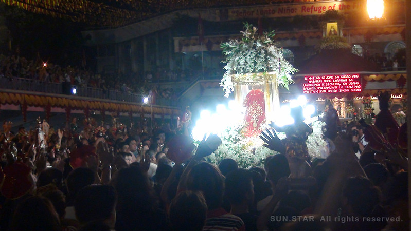 The image of Sr. Sto. Nino was brought inside the Basilica church in Cebu City after the foot procession Thursday, January 5, 2012. (Photo by Tashuana Alemania/Sunnex)