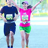 CEBU MARATHON. A female runner waves to the camera as she approaches the finish line. (Sun.Star Cebu Photo/Ruel Rosello)