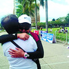 WELCOME COMMITTEE. Imma Joan Cubero cries after hugging her mother at the finish line of the Cebu City Marathon last Sunday, January 13, 2013. (Sun.Star Photo/Marian Baring)