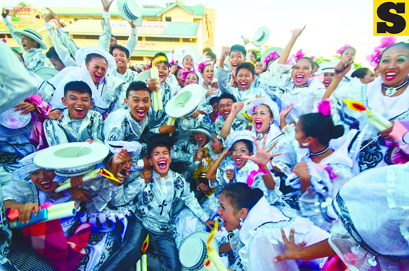 MOMENT OF TRUTH. Some of the 96 dancers and 150 props men of Carcar City's high school entry react to the announcement that they've won, for the third time, the Sinulog sa Kabataan's provincial edition. Schools in Cebu City will compete in the second leg of the children's Sinulog this afternoon. (Sun.Star Photo/Alex Badayos)