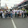 Trying to control the crowd. Abellana National School's contingent joins grand parade.  (Photo by Jean Mondoñedo-Ynot)