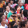 A child carries Sto Nino image during Opening Salvo Mass 2016