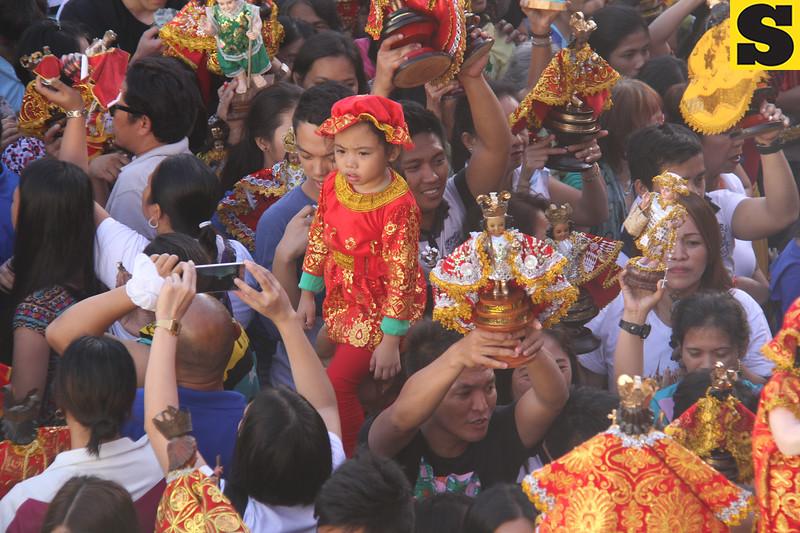 Child wearing Sto. Nino costume