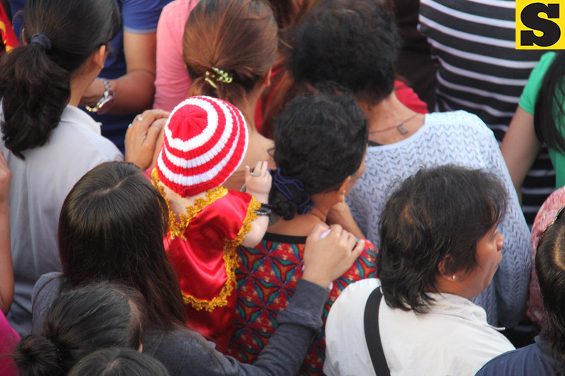 Sto Nino image in the middle of the crowd-B