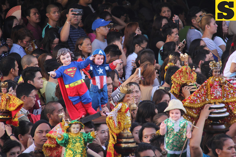 Superman and Captain America Sto Ninos among the crowd
