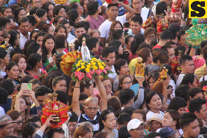 Sto Nino and Mother Mary images adorned with flowers