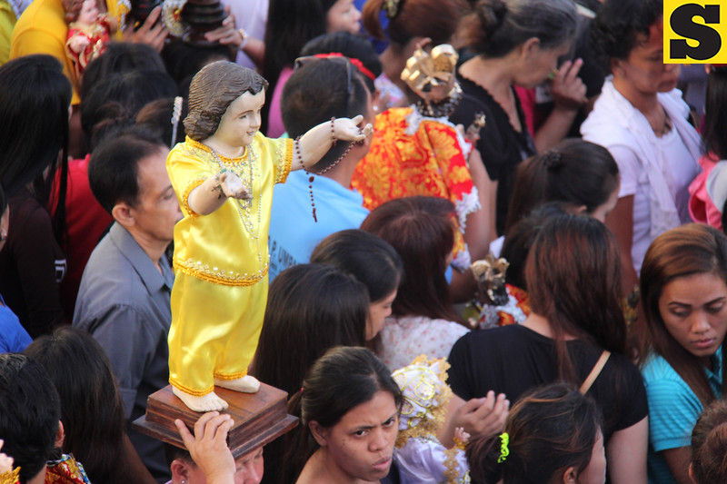 Sto Nino image wearing yellow costume