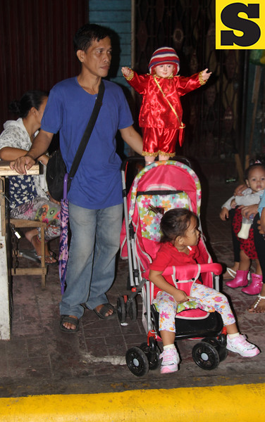 Father with his child and Sto Nino image