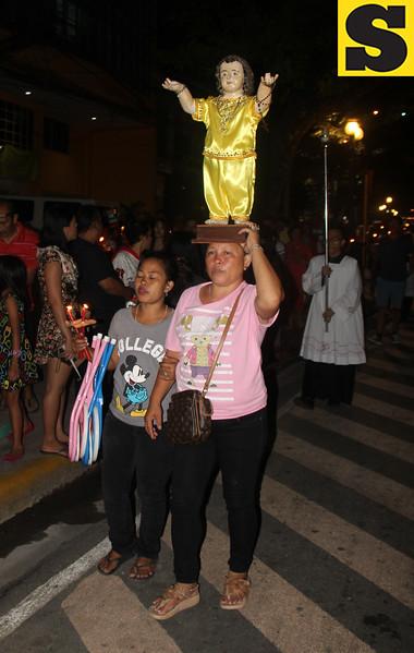 Devotee carrying Sto Nino statue