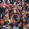 Devotees carrying icons of Sto. Nino