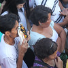 Devotee holding an icon of Mama Mary and of Sto. Nino