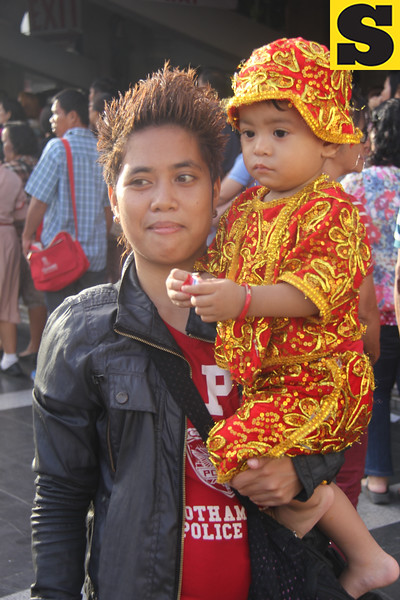Child wearing a Sto. Nino outfit