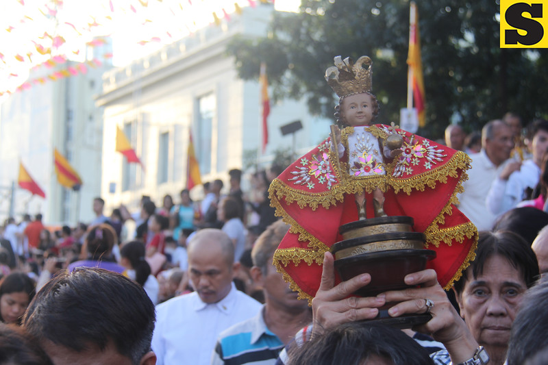 Sto. Nino carried by a devotee during  the Walk with Mary