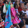 An icon of Mother Mary dressed in pink and blue.