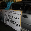A car with a tarp urging the devotees to pray the Holy Rosary