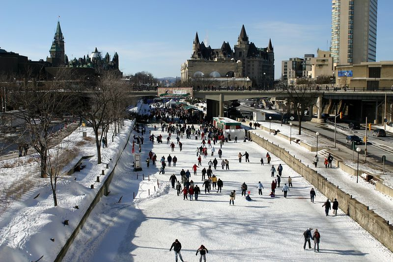 The Rideau canal with the Canadian parliament and the Chateaux Laurier hotel in the background